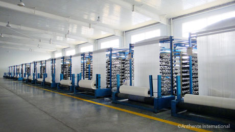 Rows of fabric spools in Shandong, China factory.