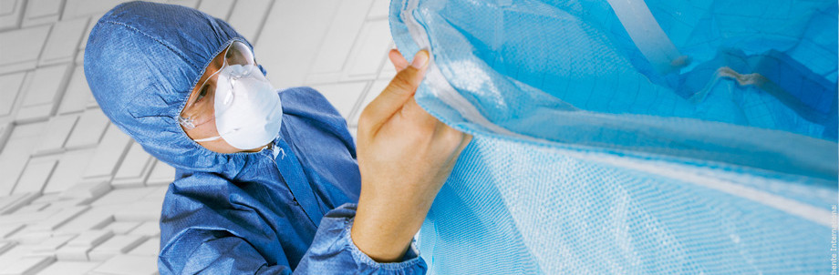 An Anthente quality assurance specialist inspecting the stitches on a finished bulk bag.